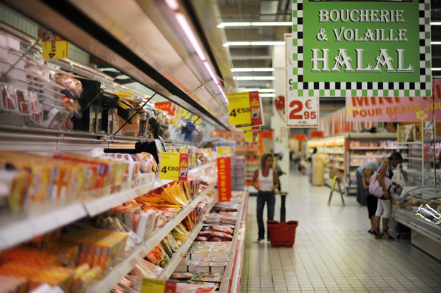 "This picture taken on August 21, 2009 in Illzach, eastern France, shows the Halal butchery and poultry shelves in a supermarket, on the eve of the beginning of the Ramadan. The start of the ninth and holiest month of the Muslim calendar is traditonally determined by the sighting of the new moon, often dividing rival Islamic countries and sects over the exact date. During Ramadan, Muslims are required to abstain from food, drink and sex from dawn until dusk as life slips into a lower gear during the day. Activity peaks between ""iftar,"" the breaking of the fast at sunset, and ""suhur"", the last meal of the day before sunrise. AFP PHOTO / SEBASTIEN BOZON (Photo credit should read SEBASTIEN BOZON/AFP/Getty Images)"